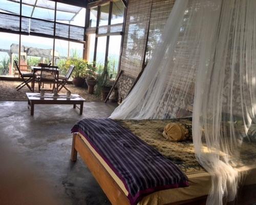Tinuku Villa Tirtasari sandstone and glass constructed on hilltops rocky coast Gunung Kidul to south sea views