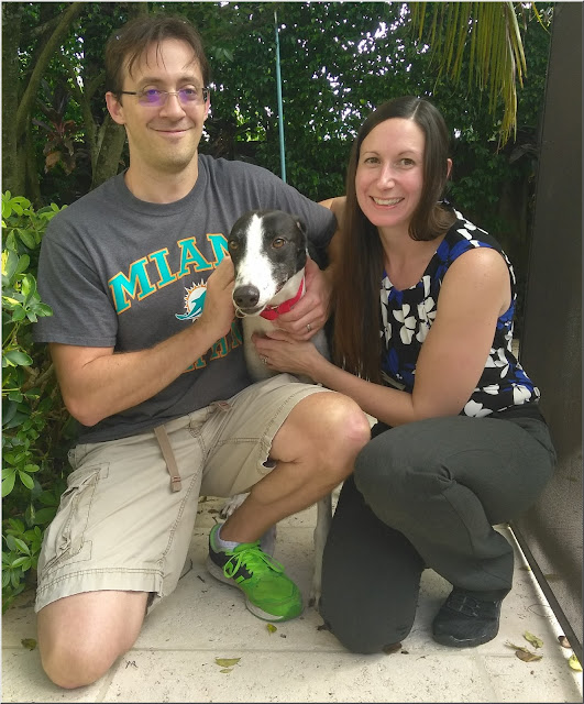 Hawk with new adoptive parents Mark and Amy