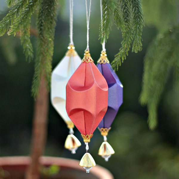 trio of dimensional paper ornaments made by hand