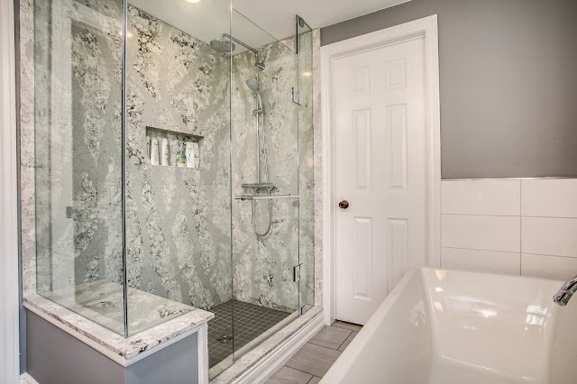 transitional white bath design with cambria quartz shower
