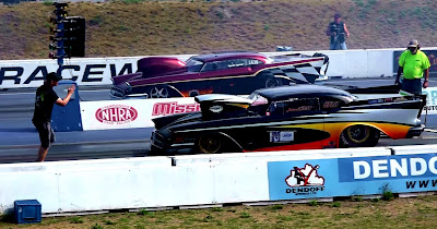 Tubbed and blown funny cars approach the start line