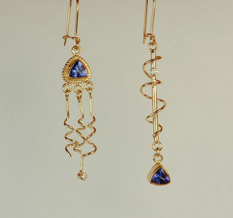 Triangular blue/purple stone earrings with twists and dangles