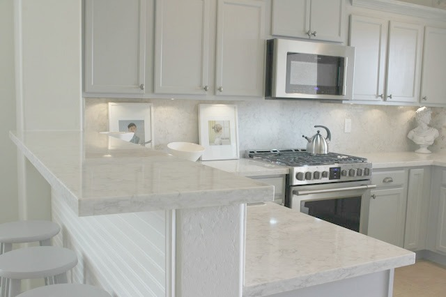 Serene chic simple European inspired kitchen with grey cabinets and Viatera Soprano quartz