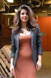 Priyanka Chopra a light orange colored dress at studio of Live With Kelly