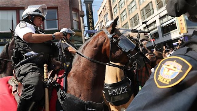 Police make arrests as clash erupt outside Republican National Convention (RNC) in Cleveland, Ohio