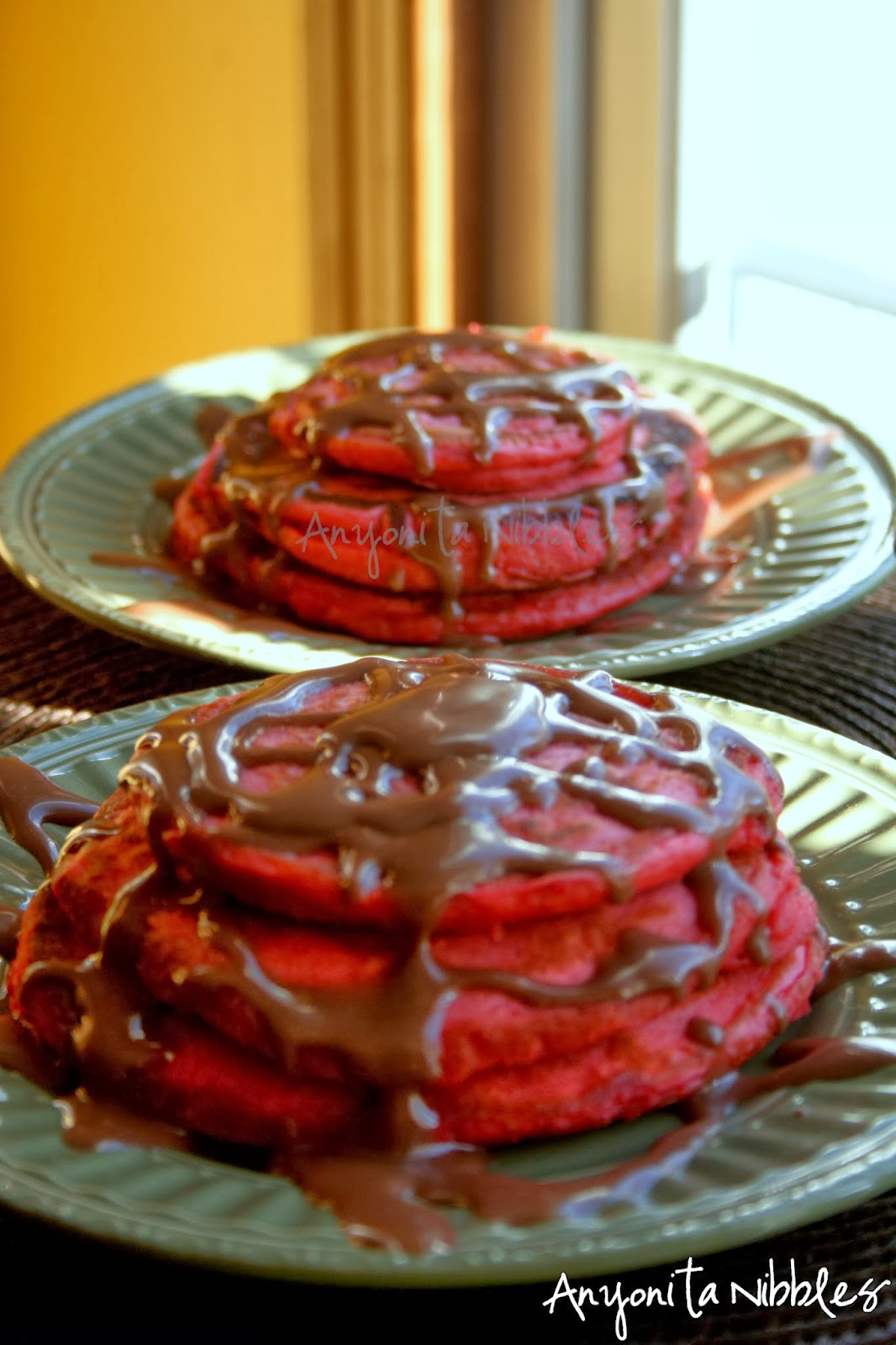 Two stacks of Red Velvet pancakes for Valentine's breakfast from www.anyonita-nibbles.com