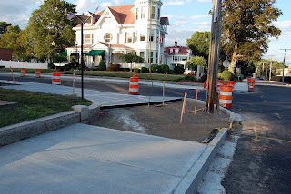 sidewalk work in progress on corner of Main and School Sts