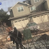 Watch: Police in Colorado draw gun in confrontation with unarmed black man who was picking up trash in his yard