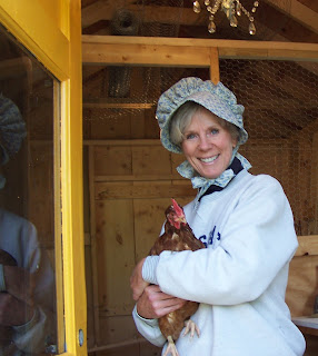 Iris cradles one of her hens on her lavender farm.