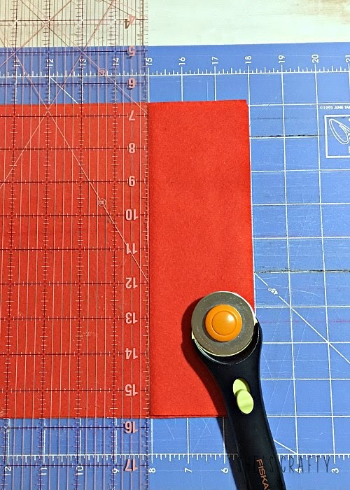 Felt Christmas tree garland, rotary cutter, ruler, cutting mat