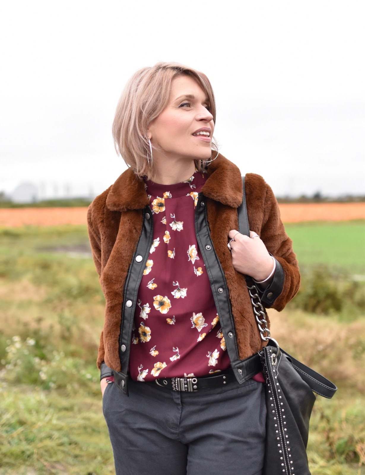 Outfit inspiration c/o Monika Faulkner - faux-fur bomber jacket, floral blouse, MK bag