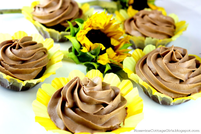 #Spring #Recipe #Cupcakes a platter of chocolate cupcakes with sunflower sitting in the midst | rosevinecottagegirls.com