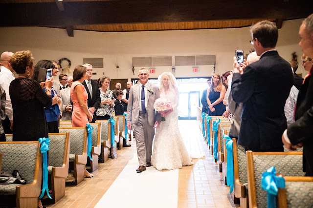 bride walking down the isle at st. malachy catholic church