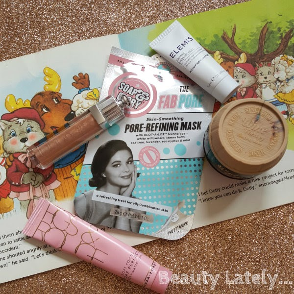 selection of skincare and makeup products on glitter background