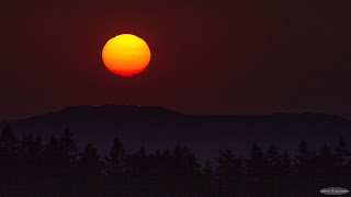 Flattened Sun over the Mountains
