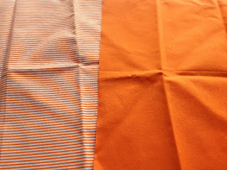 orange and orange striped fabric