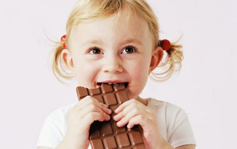 Image result for kids eating chocolate