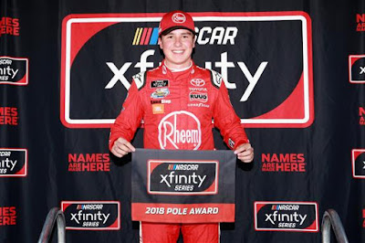 Christopher poses with the pole award after qualifying on the pole position.