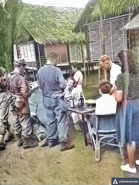Spanish evacuees from Manila welcome American soldiers.  Image source:  United States National Archives.  Colorized courtesy of Algorithmia.