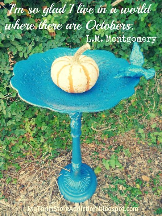 Blue bird bath adorned for fall