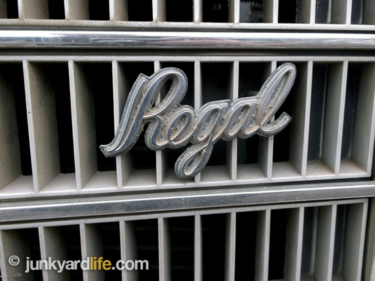 Complete Buick Regal grill and emblem has a few days before it meets the crusher.