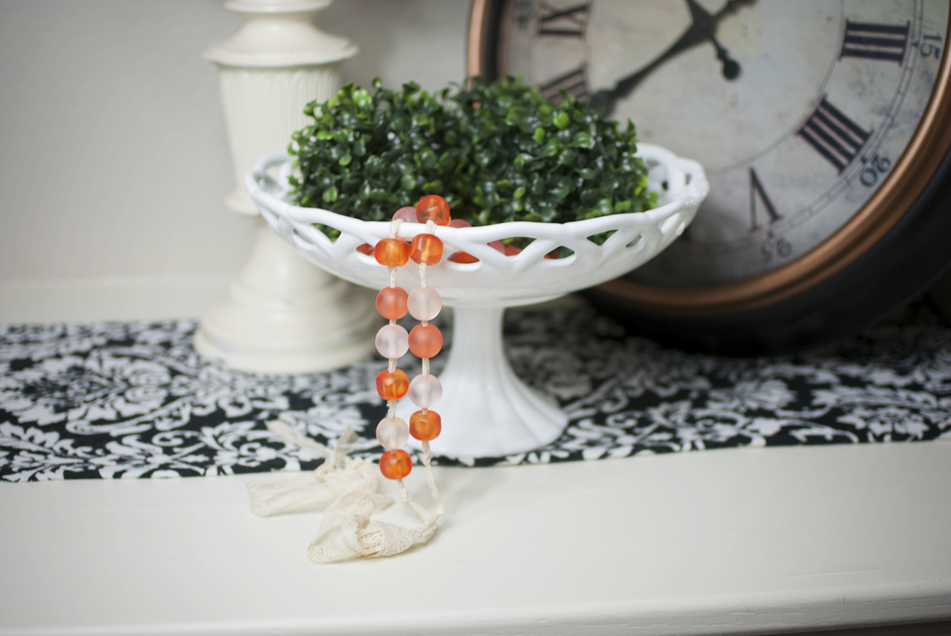 Pink and Coral Glass Beaded Garland In A White Bowl