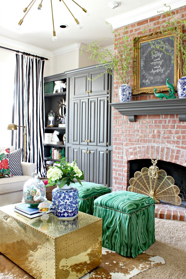 blue and white urns, spring branches, malachite malakos upholstered ottomans, brass trunk, urbane bronze trim, ballard designs julian lamp, betwixt, chiang mai dragon, brass peacock fireplace screen