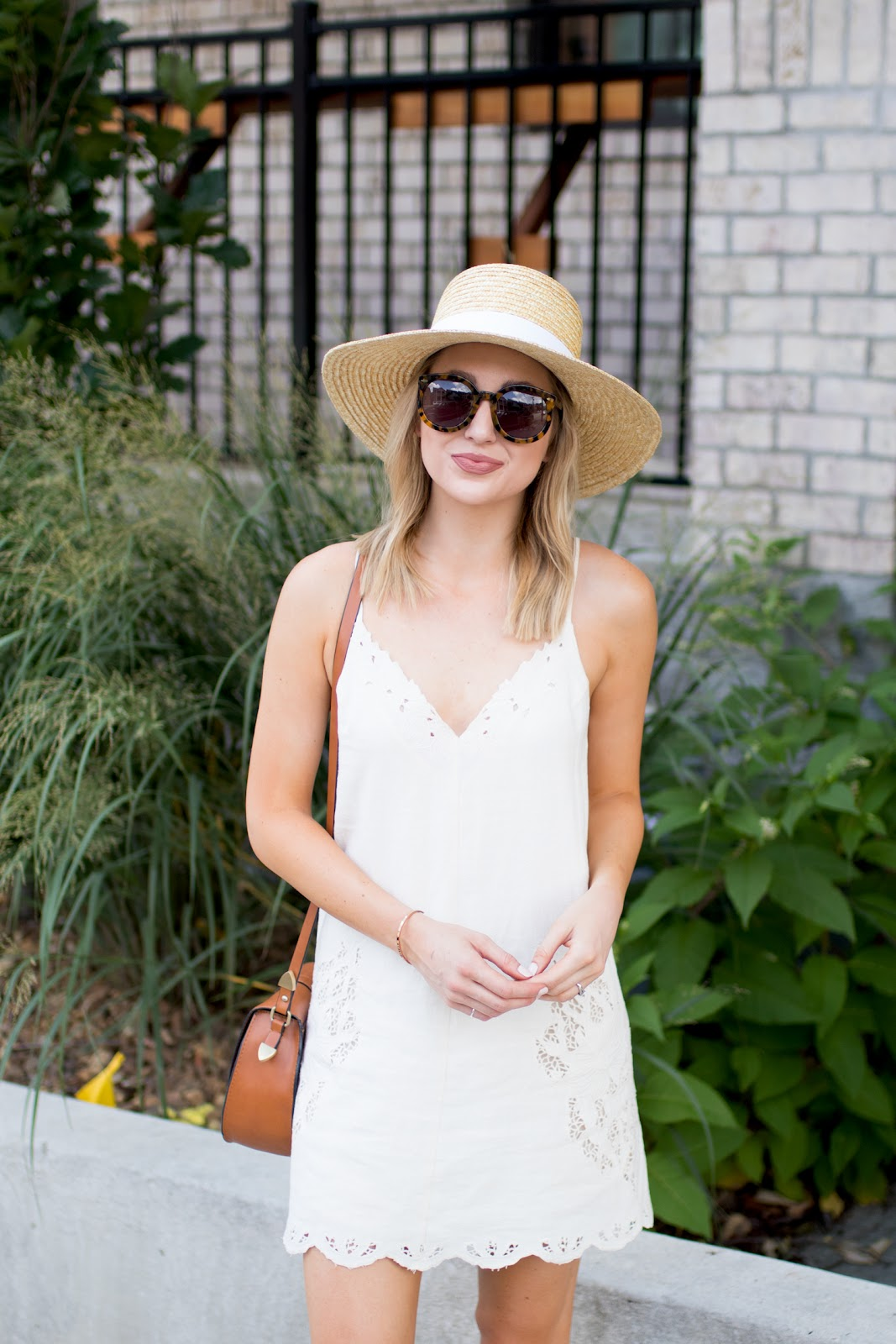 White sundress, sunglasses, wide brim hat