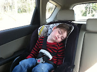 Toddler asleep in the back car seat