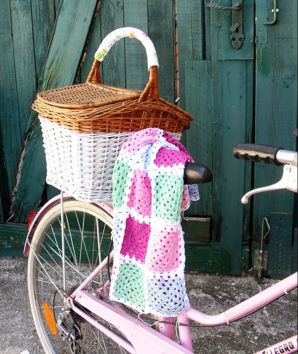 A crochet blanket, dip painted wicker basket AND a pink bicycle!