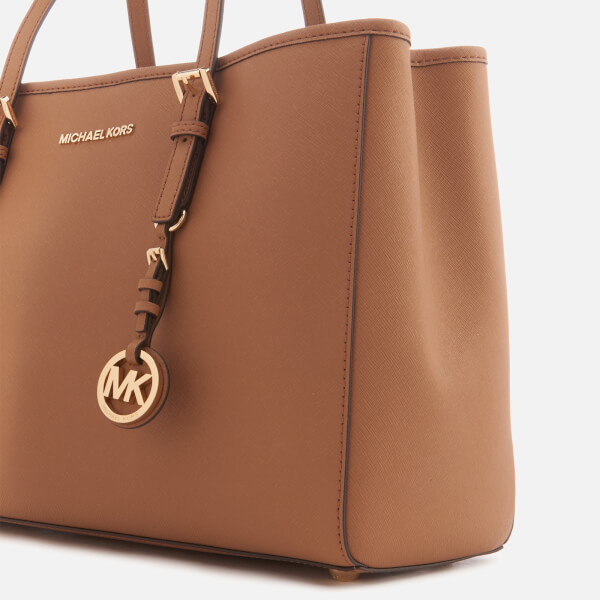 ee255f570502 Women's large leather tote bag from Michael Kors with saffiano leather  construction and structured silhouette. The 'Jet Set Travel' tote features  an open ...