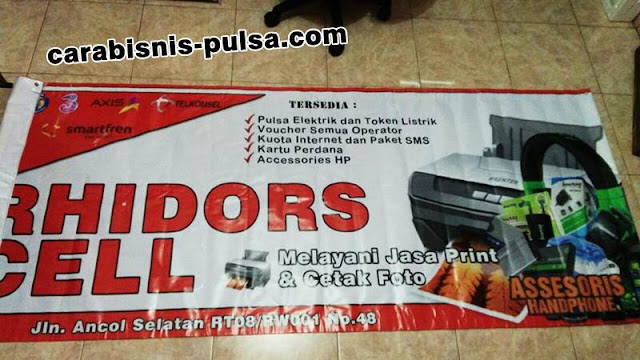 Contoh Jasa Banner Konter Rhidors Cell