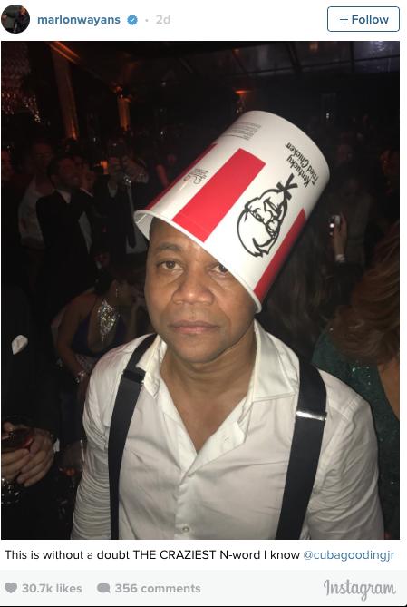 Oscar winning actor Cuba Gooding Jr. dons a KFC chicken bucket at a Golden  Globes afterparty. 442055aee3f