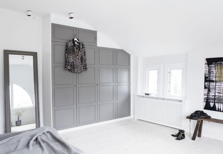 gray wardrobe insideof scandinavian interior bedroom