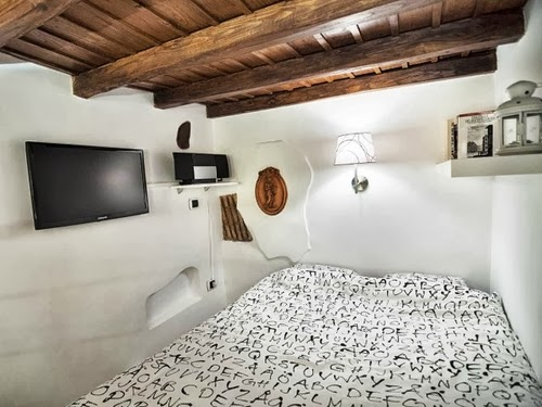11-Bedroom-With-Some-Mod-Coms-Smallest-House-in-Italy-75-sq-Feet-7-m2-Italian-Architect-Marco-Pierazzi-www-designstack-co
