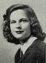 B&W yearbook portrait of a young white woman with thick, wavy, shoulder-length hair