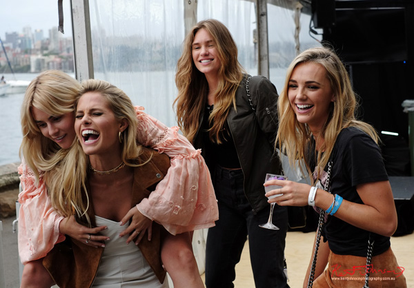 Models laugh and party, CARISSA WALFORD, Brooke Hogan, Natalie Jayne Roser, ZOE CROSS. Windsor Smith Celebrates 70 years at #HarbourLife Sydney 2016. Photographed by Kent Johnson for Street Fashion Sydney.