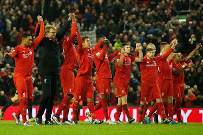 Liverpool beat Arsenal to go fourth, United held