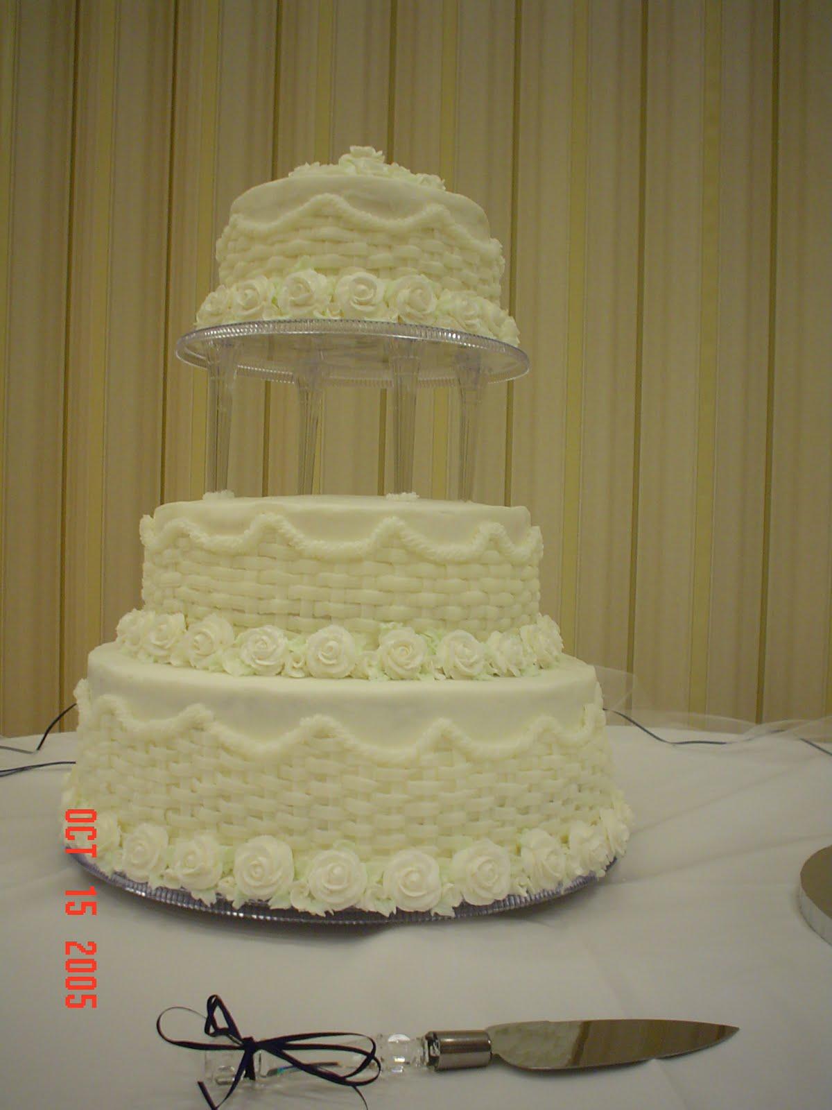 White Wedding Cake With Pillars 3 Tier