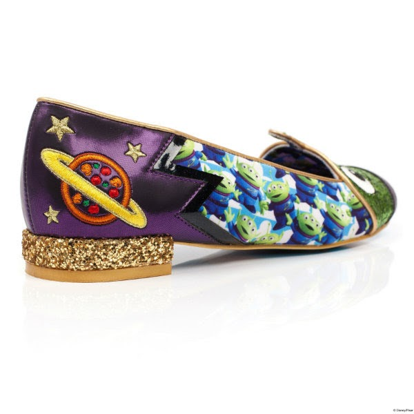 single shoe sitting at angle from heel with purple metallic material, embroidered planet on side and gold glitter heel