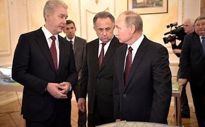 Vladimir Putin, Vitaly Mutko and Sergei Sobyanin.