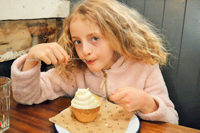 a young girl eating icecream.