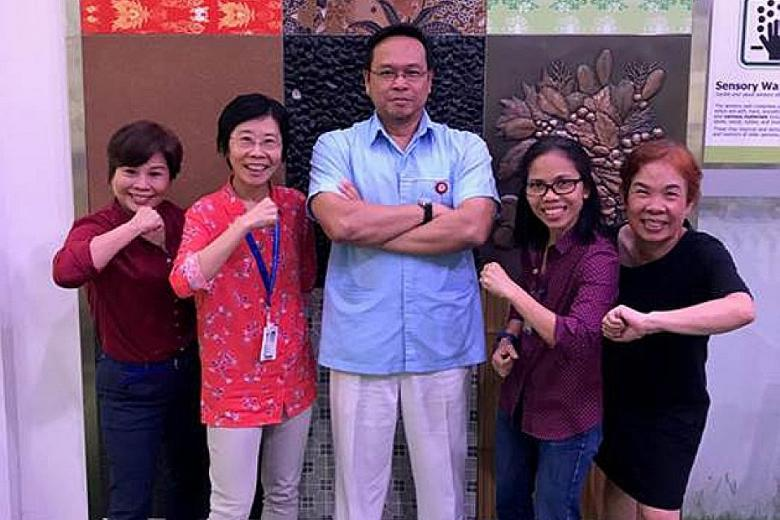 Some of the Tan Tock Seng Hospital employees who signed up for this year's Big Walk, including Mr Laley Senawi (centre) and Ms Melieve Yanson (second from right).