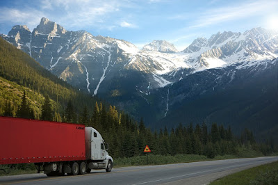 A picture of a truck, on a roadway.