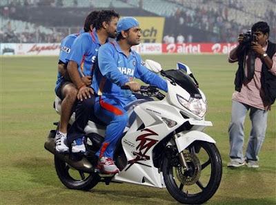 ms dhoni with bike