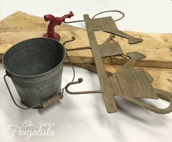 A rustic wall mount Garden Tool Holder With Flower Planter. Unique small garden tool organization for the backyard garden shed or potting bench.