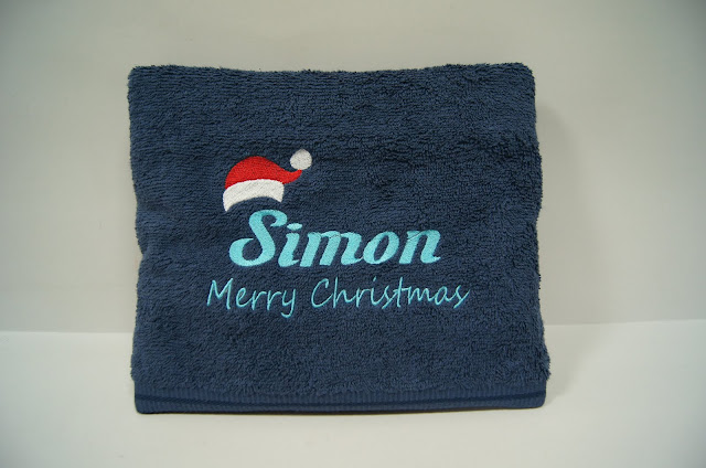 Blue towel with Christmas Themed design and name embroidery