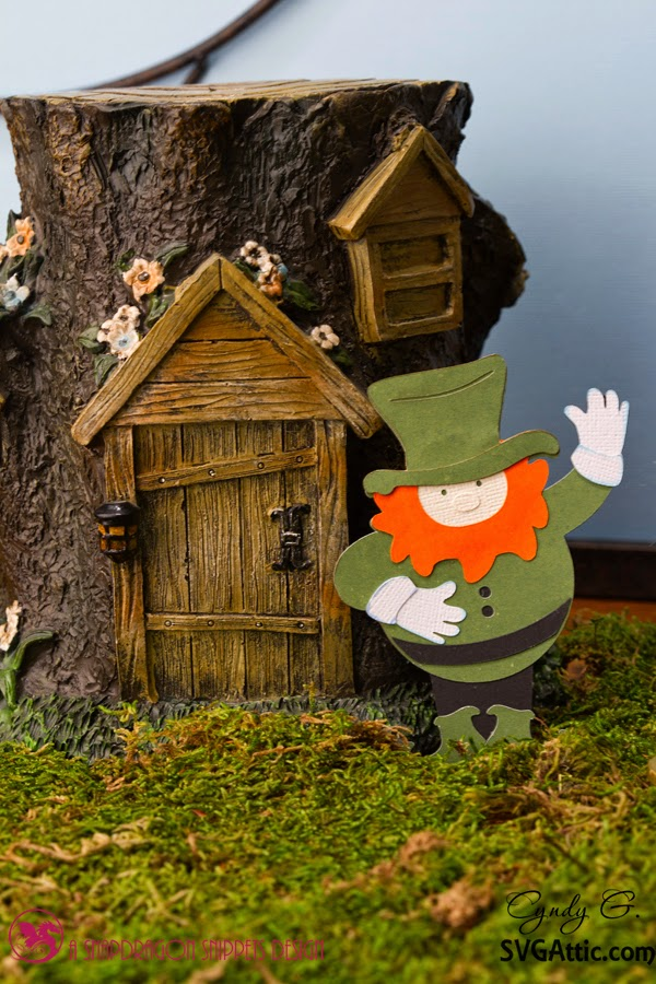 Leprechaun next to tree stump house