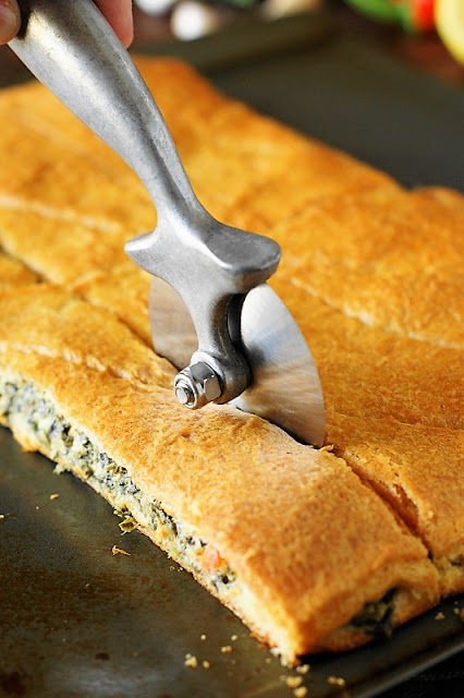 Cutting Spinach Dip Crescent Bites Image