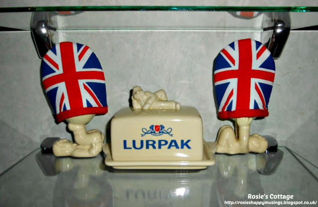 The first two Lurpak Douglas egg cups model their egg cosies.